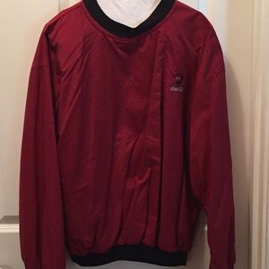 Men's Golf Windshirt with the Coca-Cola logo.